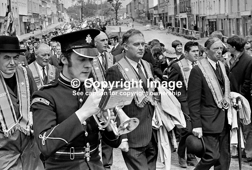 William Craig, leader of the recently-formed Ulster Vanguard Movement, parading through Banbridge on his way to at an Orange Order/Unionist rally in the Co Down town. 197206100350d.<br /> <br /> Copyright Image from Victor Patterson, 54 Dorchester Park, Belfast, UK, BT9 6RJ<br /> <br /> t1: +44 28 9066 1296 (from Rep of Ireland 048 9066 1296)<br /> t2: +44 28 9002 2446 (from Rep of Ireland 048 9002 2446)<br /> m: +44 7802 353836<br /> <br /> e1: victorpatterson@me.com<br /> e2: victorpatterson@gmail.com<br /> <br /> The use of any of my copyright images is subject to my Terms &amp; Conditions.<br /> <br /> It is IMPORTANT that you familiarise yourself with them. They are available on my website, victorpatterson.com.<br /> <br /> None of my copyright images may be used on the Internet unless they are visibly watermarked, i.e. &copy; Victor Patterson within the body of the image. Additionally metadata denoting my copyright must NOT be deleted. <br /> <br /> Web use is extra at the then currently recommended NUJ rates.