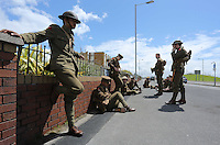 Men in World War I gear outside the Four Winds pub Port Talbot, south Wales UK. Friday 01 July 2016