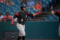 Richmond Flying Squirrels Johneshwy Fargas (8) high fives teammates after scoring a run during an Eastern League game against the Bowie Baysox on August 15, 2019 at Prince George's Stadium in Bowie, Maryland.  Bowie defeated Richmond 4-3.  (Mike Janes/Four Seam Images)
