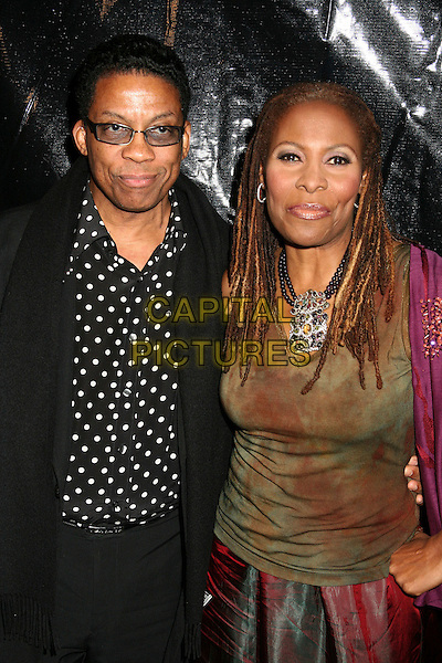 HERBIE HANCOCK & GUEST.Ebony Hosts 3rd Annual Pre-Oscar Celebration at Jim Henson Studios, Hollywood, California, USA..February 22nd, 2007.half length black jacket polka dot brown green tinted glasses .CAP/ADM/BP.©Byron Purvis/AdMedia/Capital Pictures