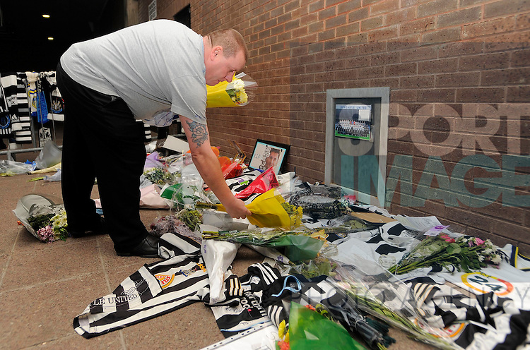 Fans lay tributes and flowers for the former Newcastle United midfielder Gary Speed who passed away last week before the Premier League football match between Newcastle United and Chelsea FC on 3 December 2011, at St. James' Park, Newcastle upon Tyne, England.