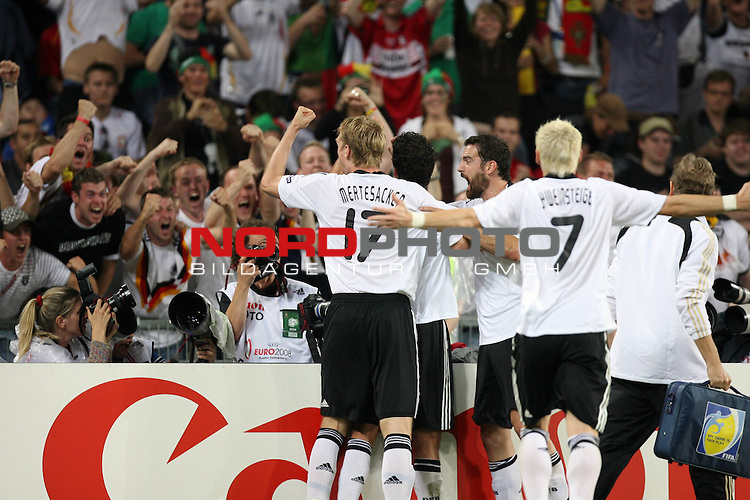 UEFA Euro 2008 Quarter-Finals Match 25 Basel - St. Jakob-Park. Portugal ( POR ) - Deutschland ( GER ). <br /> Torsch&uuml;tze Michael Ballack ( Germany / Mittelfeldspieler / Midfielder / Chelsea London #13 ) (verdeckt) feiert seinen Treffer zum 3:1 mit Per Mertesacker ( Germany / Verteidiger / Defender / Werder Bremen #17 ) (l) und Bastian Schweinsteiger ( Germany / Mittelfeldspieler / Midfielder / Bayern Muenchen #07 ) (M rechts).<br /> Foto &copy; nph (  nordphoto  )