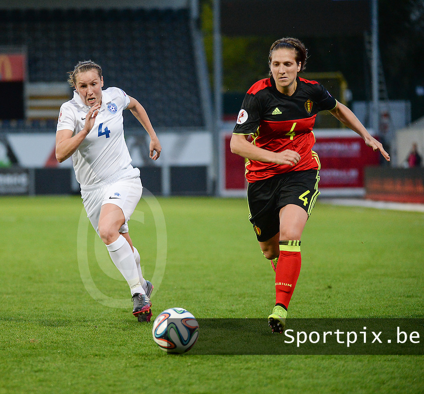 20160412 - LEUVEN ,  BELGIUM : Belgian Maud Coutereels (R) and estonian Pille Raadik (L)  pictured during the female soccer game between the Belgian Red Flames and Estonia , the fifth game in the qualification for the European Championship in The Netherlands 2017  , Tuesday 12 th April 2016 at Stadion Den Dreef  in Leuven , Belgium. PHOTO SPORTPIX.BE / DIRK VUYLSTEKE