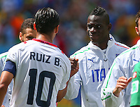 Mario Balotelli of Italy shakes hands with Bryan Ruiz of Costa Rica