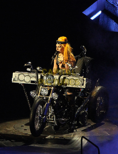 Lady Gaga (Stefani Joanne Angelina Germanotta).performs live in concert at the Constitutiei Square in Bucharest, Bucharest, Romania, .16 August 2012..music on stage gig performing full length black motorcycle motorbike bike keyboard playing dress boots orange hair wig .CAP/ADM/HEP.© Silviu Matei/Hepta/AdMedia/Capital Pictures.