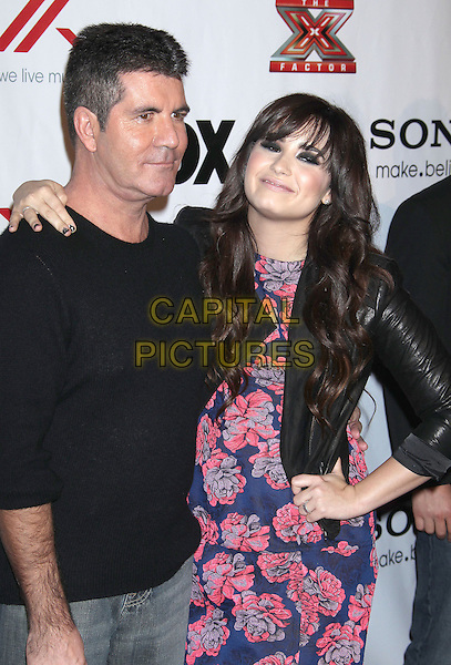 "Simon Cowell, Demi Lovato.""The X-Factor"" Viewing Party Sponsored By Sony X Headphones held at Mixology at The Grove, Los Angeles, California, USA, December 7th 2012..half length top arm around  black leather dress red floral print navy blue fringe make-up blusher eyeliner beauty hand on hip dress .CAP/ADM/RE.©Russ Elliot/AdMedia/Capital Pictures."