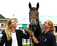 So Sleek with stable staff in the winners enclosure during Afternoon Racing at Salisbury Racecourse on 7th August 2017