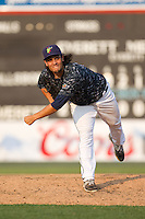 Dylan Silva (24) of the Everett Aquasox delivers a pitch during a game against the Hillsboro Hops at Everett Memorial Stadium in Everett, Washington on July 5, 2015.  Hillsboro defeated Everett 11-4. (Ronnie Allen/Four Seam Images)