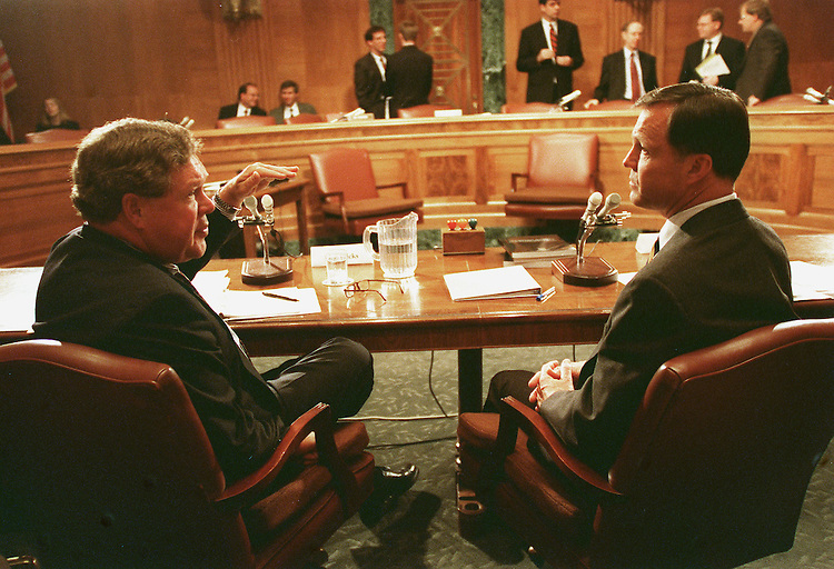 6/10/99.EXPORT ADMINISTRATION ACT REAUTHORIZATION-- Norm Dicks, D-Wash., and Christopher Cox, R-Calif., talk during a break in the Senate Banking, Housing and Urban Affairs Committee hearing on the Export Administration Act. The Cox Report on China's acquisition of U.S. nuclear secrets recommends heightened export controls..CONGRESSIONAL QUARTERLY PHOTO BY SCOTT J. FERRELL