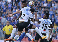 BOGOTA - COLOMBIA -26 -07-2015: Johan Arango, Michael Ordoñez y Luis Carlos Murillo jugadores del Once saltan or el balón durante el encuentro entre Millonarios y Once Caldas por la fecha 3 de la  Liga Águila II 2015 jugado en el estadio Nemesio Camacho El Campín de la ciudad de Bogotá./ Johan Arango, Michael Ordoñez and Luis Carlos Murillo players of Once jump for the ball during the match between Millonarios and Once Caldas for the third date of the Aguila League II 2015 played at Nemesio Camacho El Campin stadium in Bogotá city. Photo: VizzorImage / Gabriel Aponte / Staff.