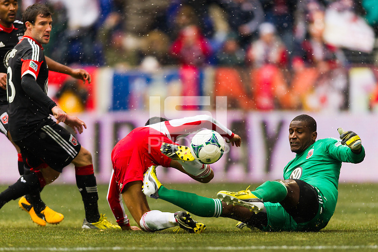 D. C. Unitedgoalkeeper Bill Hamid (28) looks to knock the ball away from Tim Cahill (17) of the New York Red Bulls. The New York Red Bulls and D. C. United played to a 0-0 tie during a Major League Soccer (MLS) match at Red Bull Arena in Harrison, NJ, on March 16, 2013.