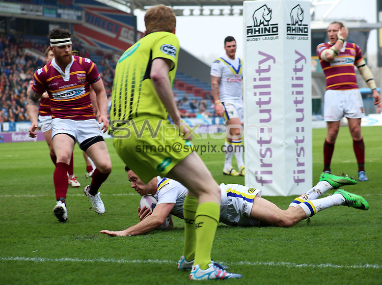 Picture by Harry Whitehead/SWpix.com - 30/03/2014 - Rugby League - First Utility Super League - Huddersfield Giants v Warrington Wolves - John Smith's Stadium, Huddersfield, England - Warrington's Richie Myler scores a try