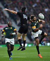 Willie Le Roux of South Africa competes with Nehe Milner-Skudder of New Zealand for the ball in the air. Rugby World Cup Semi Final between South Africa and New Zealand on October 24, 2015 at Twickenham Stadium in London, England. Photo by: Patrick Khachfe / Onside Images