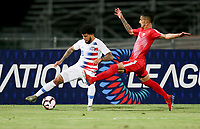 GEORGETOWN, GRAND CAYMAN, CAYMAN ISLANDS - NOVEMBER 19: DeAndre Yedlin #2 of the United States traps the ball while Cuba's Rolando Abreu #7 slides over during a game between Cuba and USMNT at Truman Bodden Sports Complex on November 19, 2019 in Georgetown, Grand Cayman.