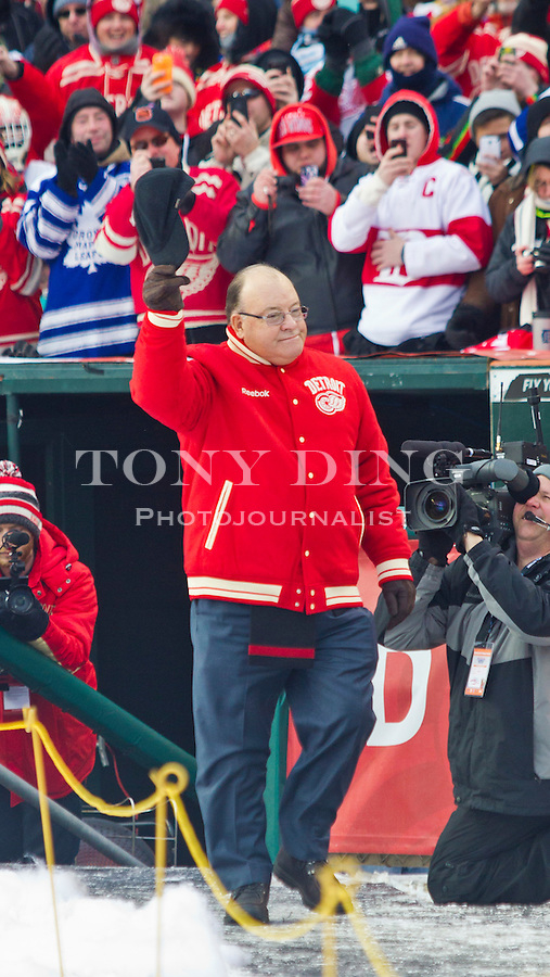 31 December 2013: Former Detroit Red Wings coach Scott Bowman waves to the crowd as he is introduced before the Toronto Maple Leafs v Detroit Red Wings Alumni Showdown hockey game, at Comerica Park, in Detroit, MI.
