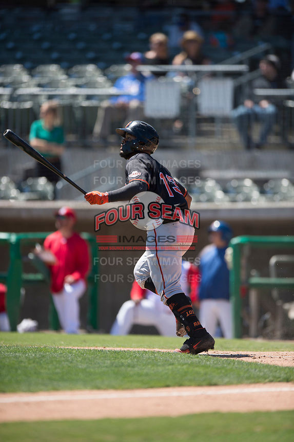 San Jose Giants center fielder Heliot Ramos (13) hits a home run during a California League game against the Stockton Ports on April 9, 2019 in Stockton, California. San Jose defeated Stockton 4-3. (Zachary Lucy/Four Seam Images)