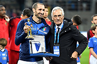 Giorgio Chiellini of Italy receives a prize from president Gabriele Gravina for his 100th match with the national team ahead the Nations League League A group 3 football match between Italy and Portugal at stadio Giuseppe Meazza, Milano, November, 17, 2018 <br /> Foto Andrea Staccioli / Insidefoto