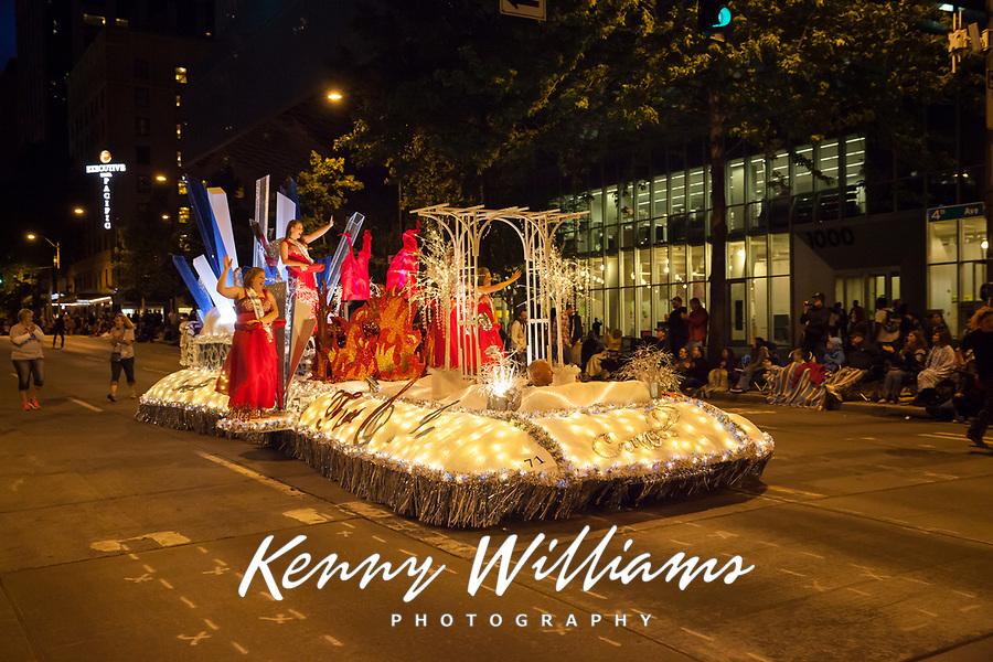 Lit Beauty Pagent Float at Night, Seafair Torchlight Parade 2015, Seattle, Washington State, WA, America, USA.