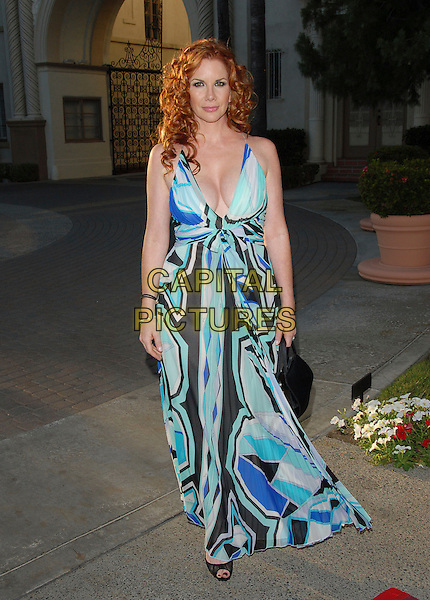 MELISSA GILBERT.The FX Season 4 Premiere Screening of Nip/Tuck held at The Paramount Studios in Hollywood, California, USA..August 25th, 2006.Ref: DVS.Nip Tuck full length blue pattern dress cleavage.www.capitalpictures.com.sales@capitalpictures.com.©Debbie VanStory/Capital Pictures