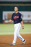AZL Indians shortstop Tyler Freeman (7) jokes with Gabriel Mejia (not pictured) between innings of a game against the AZL Rangers on August 26, 2017 at Goodyear Ball Park in Goodyear, Arizona. AZL Indians defeated the AZL Rangers 5-3. (Zachary Lucy/Four Seam Images)