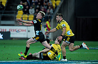 Damien McKenzie loses the ball forward during the Super Rugby quarterfinal match between the Hurricanes and Chiefs at Westpac Stadium in Wellington, New Zealand on Friday, 20 July 2018. Photo: Dave Lintott / lintottphoto.co.nz