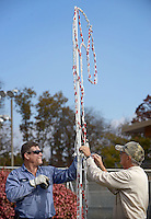 NWA Democrat-Gazette/BEN GOFF @NWABENGOFF<br /> Sean Breen (left) and Ron Elliot with the Bella Vista POA install Christmas lights on Monday Nov. 2, 2015 at the Kingsdale Recreation Complex in Bella Vista. The display will be lit during the Nov. 20 Home for the Holidays event from 6-9:00pm at the complex.