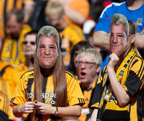 13.04.2014.  London, England.  Steve Bruce masks are the order of the day amongst the Hull fans before the FA Cup Semi-Final between Hull City and Sheffield United from Wembley Stadium.