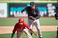 New York Yankees Nelson Gomez (50) reaches out to tag Luis Garcia (5) during a Florida Instructional League game against the Philadelphia Phillies on October 12, 2018 at Spectrum Field in Clearwater, Florida.  (Mike Janes/Four Seam Images)