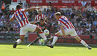 Leeds United's Pablo Hernandez shoots between Stoke City's Cameron Carter-Vickers and Nathan Collins<br /> <br /> Photographer Stephen White/CameraSport<br /> <br /> The Premier League - Stoke City v Leeds United - Saturday August 24th 2019 - bet365 Stadium - Stoke-on-Trent<br /> <br /> World Copyright © 2019 CameraSport. All rights reserved. 43 Linden Ave. Countesthorpe. Leicester. England. LE8 5PG - Tel: +44 (0) 116 277 4147 - admin@camerasport.com - www.camerasport.com