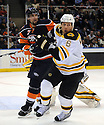 Jan 15, 2009; Uniondale, NY, USA; Boston Bruins defenseman Dennis Wideman (6) trys to get away from New York Islanders rightwing Trent Hunter (7) at the Nassau Coliseum. Mandatory Credit: Tomasso DeRosa