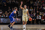 Mitchell Wilbekin (10) of the Wake Forest Demon Deacons calls out a play as he brings the ball up the court during first half action against the UNC Asheville Bulldogs at the LJVM Coliseum on November 14, 2014 in Winston-Salem, North Carolina.  The Demon Deacons defeated the Bulldogs 80-69  (Brian Westerholt/Sports On Film)