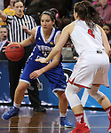 SIOUX FALLS MARCH 22:  Kelsey Hoppel #23 of Lubbock Christian dribbles toward Florida Southern defender Flo Ward #4 during their quarterfinal game at the NCAA Women's Division II Elite 8 Tournament at the Sanford Pentagon in Sioux Falls, S.D. (Photo by Dick Carlson/Inertia)