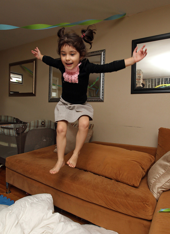 Ava jumping off the couch at home in Charlottesville, VA. Photo/Andrew Shurtleff