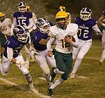 Manogue quarterback Drew Scolari (12) runs away from the  Spanish Springs defense on Friday night, November 9, 2018 at Spanish Springs High School in Sparks, Nevada.
