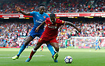 Liverpool's Georginio Wijnaldum (R) in action with Arsenal's Danny Welbeck during the premier league match at Anfield Stadium, Liverpool. Picture date 27th August 2017. Picture credit should read: Paul Thomas/Sportimage