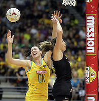 10.07.2011 Silver Ferns Irene Van Dyk and Australia's Susan Fuhrmann in action during the final netball match between the Silver Ferns v Australia at the Mission Foods World Netball Championship 2011 held at the Singapore Indoor Stadium in Singapore . Mandatory Photo Credit ©Michael Bradley.