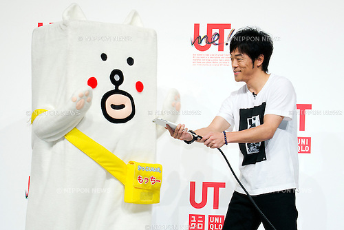 """(L to R) Motchy The Kakkoi-inu character and the actor Tomonori Jinnai attend a special Uniqlo media event to promote the """"UTme!"""" smart phone application on April 28, 2015. The application allows customers to upload their own designs to sell through """"UTme! Market"""". Customers also can select new effects, characters and designs from Coca-Cola, Mottchy the Kakkoii-inu and fashion magazine Non-no. (Photo by Rodrigo Reyes Marin/AFLO)"""