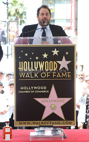 HOLLYWOOD, CA - APRIL 26: Brett Ratner pictured as Chef Wolfgang Puck is honored with a Star on the Hollywood Walk of Fame on April 26, 2017 in Hollywood, California. Credit: FS/MediaPunch