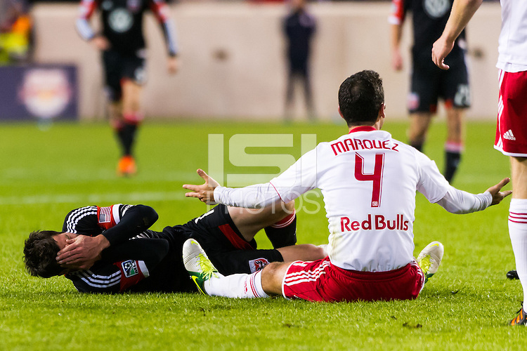 Rafa Marquez (4) of the New York Red Bulls pleads his case after fouling Chris Pontius (13) of D. C. United on a header. D. C. United defeated the New York Red Bulls 1-0 (2-1 in aggregate) during the second leg of the MLS Eastern Conference Semifinals at Red Bull Arena in Harrison, NJ, on November 8, 2012.