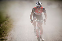 Fumy Beppu (JAP/Trek-Segafredo) biting the dust one very last time on the white dust roads of Tuscany (in his last season as a pro)<br />