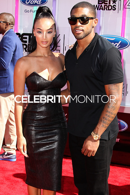 LOS ANGELES, CA, USA - JUNE 29: Draya Michele and Orlando Scandrick arrive at the 2014 BET Awards held at Nokia Theatre L.A. Live on June 29, 2014 in Los Angeles, California, United States. (Photo by Xavier Collin/Celebrity Monitor)