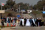 Arwad Abu Shaheen walks toward her fiancé as she is escorted through a UN zone at the Quneitra border-crossing, Israel-Syria border.