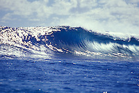 Wave breaking in a tube in clear blue water, Tahiti, Society Islands, French Polynesia