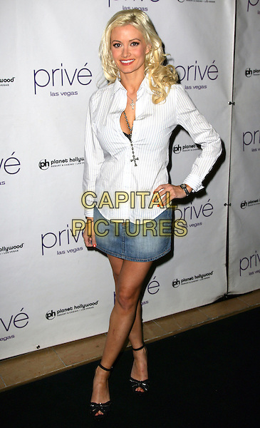 HOLLY MADISON.Holly Madison hosts a night at Prive' inside the Planet Hollywood Resort Hotel and Casino, Las Vegas, Nevada, USA, 21st March 2009.full length white shirt denim mini skirt black ankle strap shoes pinstripe hand on hip cross necklace bra showing open toe .CAP/ADM/MJT.©MJT/Admedia/Capital Pictures