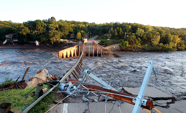 The breached dam at Lake Delhi Sunday morning, July 25, 2010.  Flood water breached and destroyed the dam the day before, emptying the nine mile long lake.