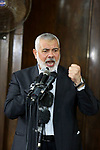 """Chairman of the political bureau of the Hamas Palestinian Islamist movement, Ismail Haniyeh speaks during the funeral of six members of Ezzedine al-Qassam Brigades, the armed wing of the Palestinian Hamas movement who were killed in an unexplained explosion the night before, in Deir al-Balah in the central Gaza strip on May 6, 2018. Gaza's health ministry confirmed six people were killed and three others wounded in what residents said appeared to be an accidental explosion in the Az-Zawayda area of the central Gaza Strip. Al-Qassam Brigades blamed Israel for the explosion without providing details or proof, saying incident occurred during a """"complex security and intelligence operation"""" and calling it a """"serious and large security incident"""". Photo by Ashraf Amra"""