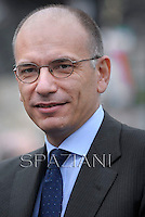 Italian Prime Minister Enrico Letta.Pope Francis  leads a mass outside the St Francis Basilica as part of his pastoral visit in Assisi on October 4, 2013.