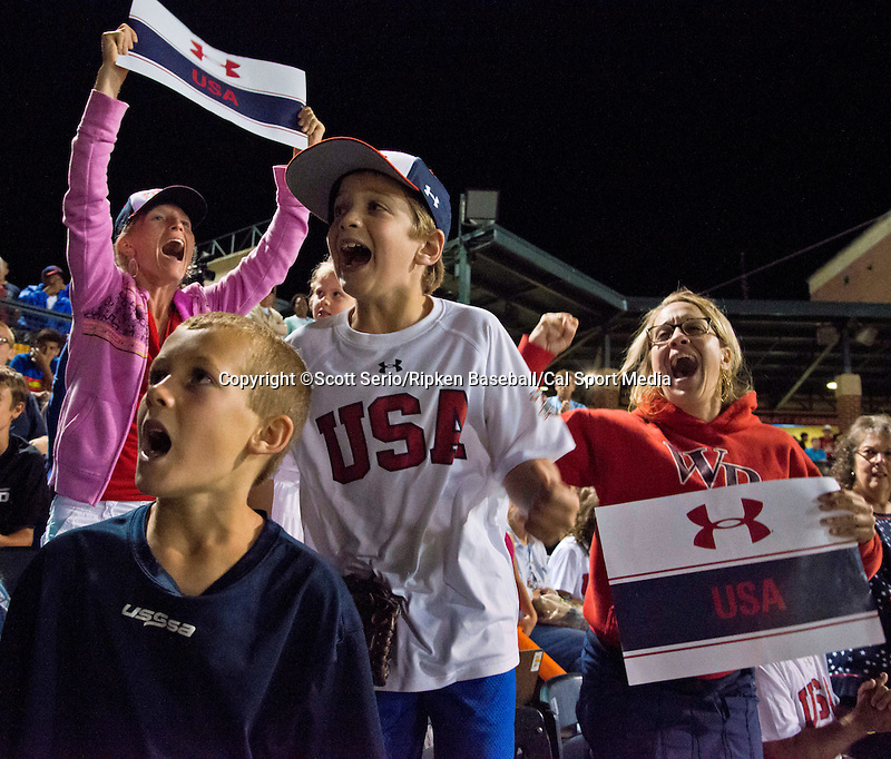 August 16, 2014: Fans celebrate Team United States, from Raleigh, N.C., win in the Cal Ripken 12u 70-foot World Series World Championship at the Ripken Experience powered by Under Armour in Aberdeen, Maryland on August 16, 2014. Scott Serio/Ripken Baseball/CSM