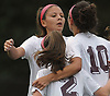 Cailey Welch #10 of North Shore, right, gets congratulated by teammates Selena Fortich #14, left, and Ryleigh Gilligan #2 after scoring the game-tying goal early in the second half of a Nassau County varsity girls soccer match against Garden City at North Shore High School on Monday, Sept. 18, 2017. North Shore scored again midway through the second half to win 2-1.