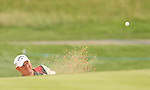 Welsh golfer Gareth Wright plays from the sand on the 4th hole during the opening round of the ISPS Handa Wales Open 2013 at the Celtic Manor Resort<br /> <br /> 29.08.13<br /> <br /> ©Steve Pope-Sportingwales